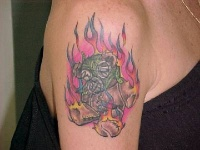 Old teddy bear in flame tattoo